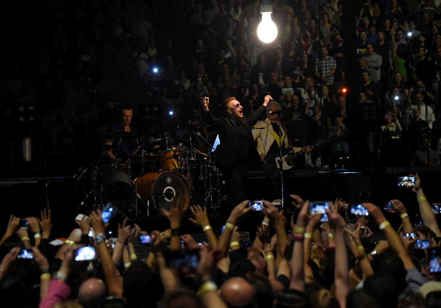 VANCOUVER, BC - MAY 14:  (L-R) Musicians Larry Mullen Jr., Bono and Adam Clayton of U2 perform onstage during the U2 iNNOCENCE + eXPERIENCE tour opener in Vancouver at Rogers Arena on May 14, 2015 in Vancouver, Canada.  (Photo by Kevin Mazur/WireImage) *** Local Caption *** Larry Mullen Jr.;Bono;Adam Clayton